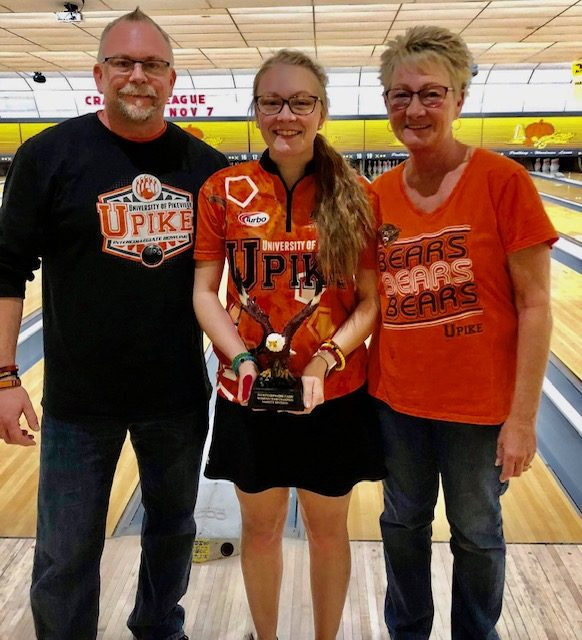 Photo providedMike Piotrowski with daughter Lauren May, center, and wife Lynn, is averaging over 200 in three different leagues.