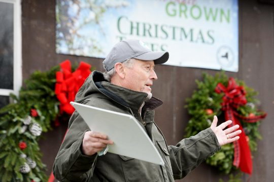 ERICA MILLER/STAFF PHOTOGRAPHER New York State Agriculture and Markets Commissioner Richard Ball promotes local Christmas tree-cutting at Goderie's Tree Farm in Johnstown on Monday. Ball was drawing attention to the opportunities for people to cut their own Christmas trees in New York.