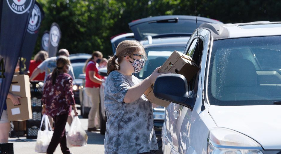 Drive-thru food distribution in Ballston Spa in August. File