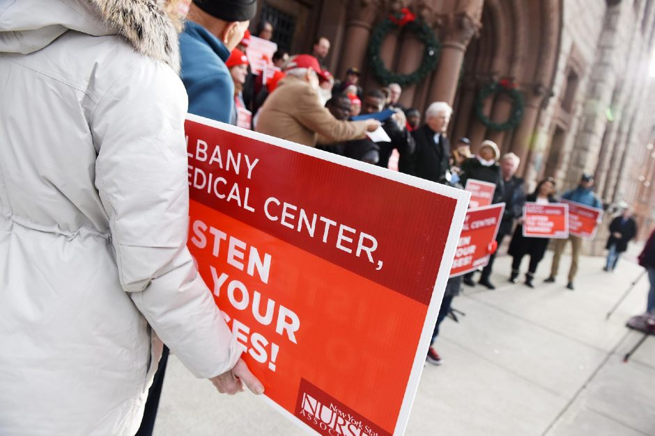 In this file photo, nurses gather during a prayer vigil held in support of Albany Medical Center nurses in their fight for a new contract on the steps of Albany City Hall last December. (Erica Miller/Staff Photographer)