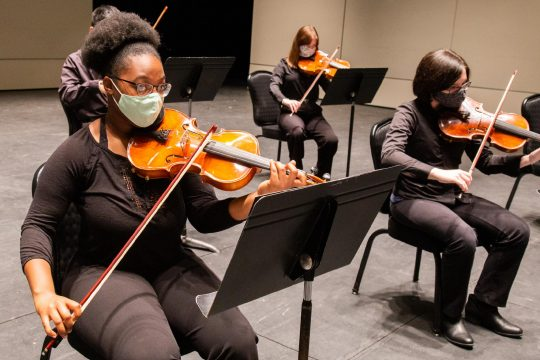 Performing in a recorded concert at Proctors are ESYO Symphony Orchestra members Gerdlie Jean Louis, left, viola, and Samantha Baker, viola. In the back row is violist Allison Headly.(photos courtesy of Anne-Marie Gorman Doyle)