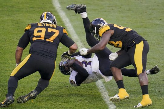 Gene J. Puskar/The Associated PressBaltimore Ravens quarterback Robert Griffin III flies as he is tripped up after he scrambled past Pittsburgh Steelers defensive end Cameron Heyward (97) and inside linebacker Vince Williams in the first half during Wednesday in Pittsburgh.
