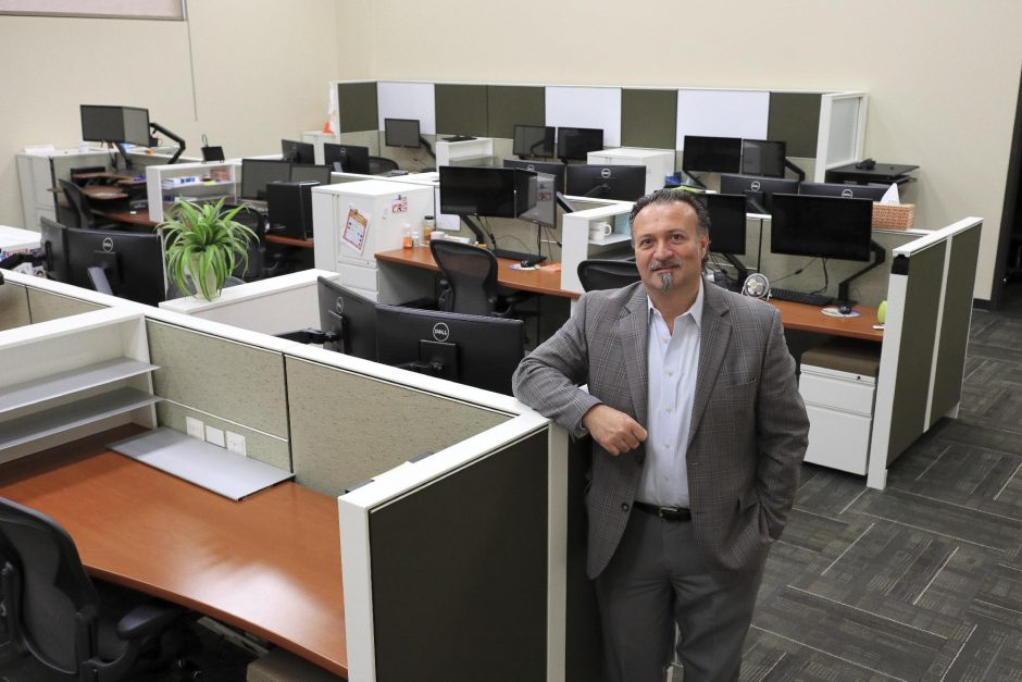 JOHN CROPLEY/BUSINESS EDITORTransfinder President and CEO Antonio Civitella stands in a deserted computer lab at the company's Schenectady headquarters on Monday.