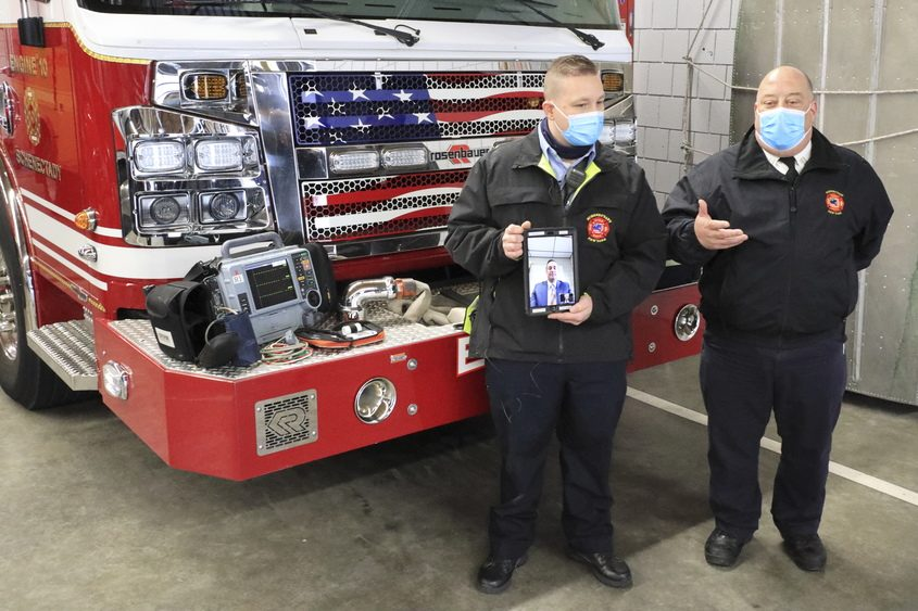 JOHN CROPLEY/BUSINESS EDITORFirefighter Nathan Kuhl, left, and Capt. Stanley Wilgoki demonstrate the telemedicine equipment the Schenectady Fire Department has begun using.