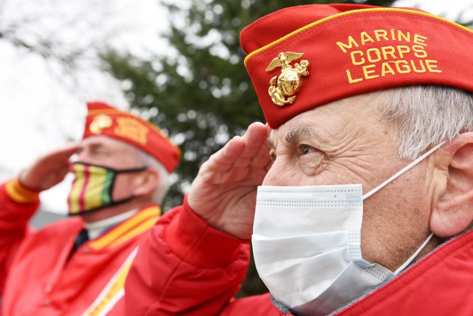 Marine Veterans Michael Carhidi, of Rotterdam (front), and Rick Pryor, of Niskayuna, salute as they salute during the National Anthem at the annual Pearl Harbor Day service outside Rotterdam Town Hall in Rotterdam on Monday, December 7, 2020.