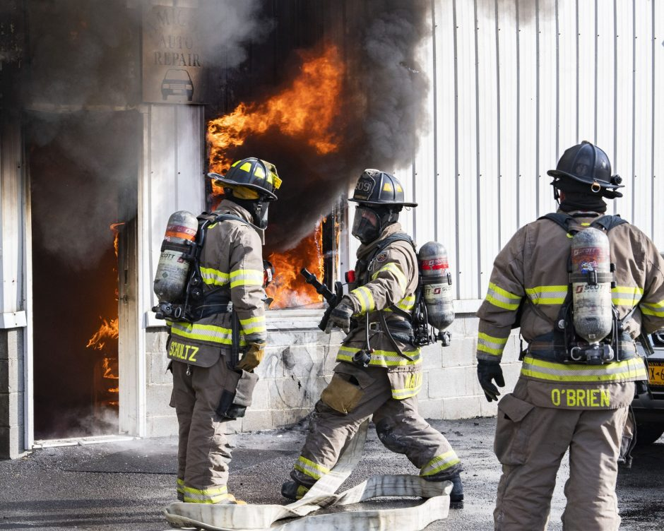 Schenectady firefighters battle a two-alarm fire at Amigo's Auto Repair at 1567 State St.  after flames erupted shortly before noon Friday, December 11, 2020.