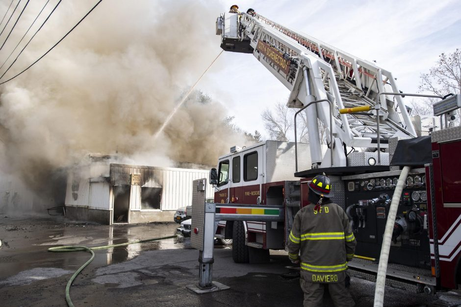 Schenectady firefighters battle a two-alarm fire at Amigo'€™s Auto Repair at 1567 State St. after flames erupted shortly before noon Friday, December 11, 2020.