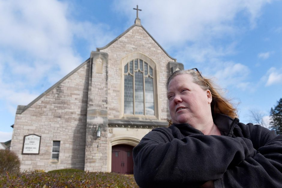 Colleen Garbarini, of Schenectady, stands outside the St. Paul the Apostle church in Schenectady