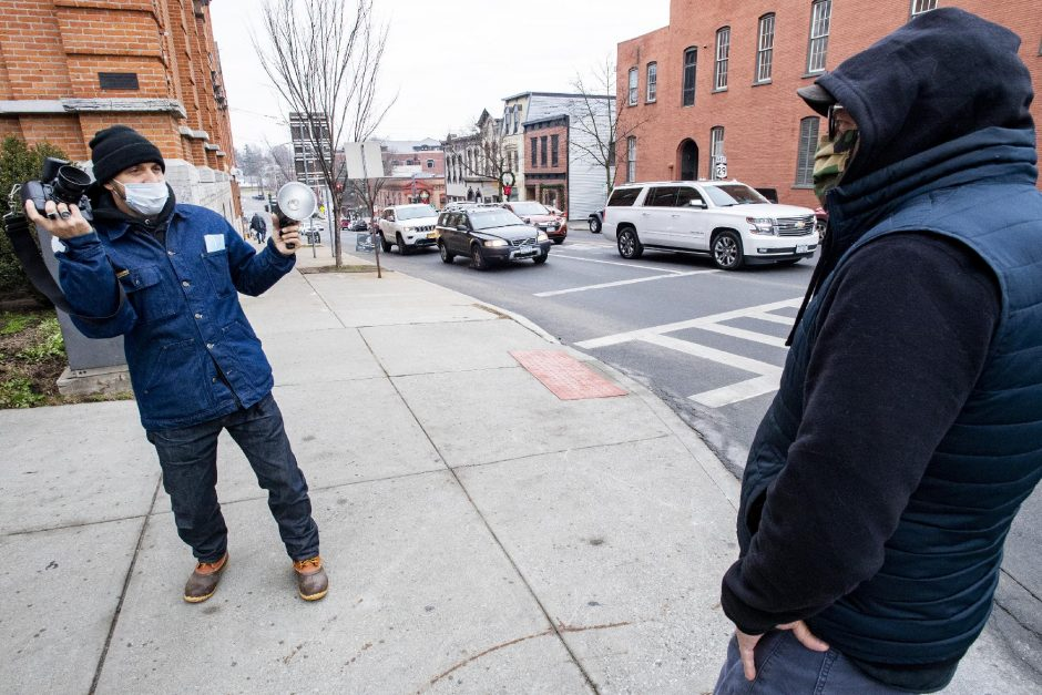 Jon Dragonette photographs Joe Petersen at the corner of Lake Avenue and Broadway in Saratoga Springs on Saturday. (Peter R. Barber/Staff Photographer)