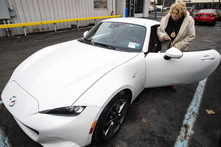 PETER R. BARBER/STAFF PHOTOGRAPHERJudy Atchison gets into her new limited edition Mazda sports car at DePaula Mazda on Central Avenue in Albany Saturday.