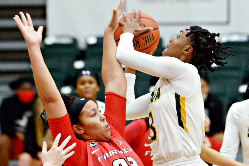 Siena's Rayshel Brown, right, takes a shot during last Friday's game. (Erica Miller)