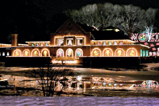 A view of the fully light lake house in Washington Park, part of the 24th annual Capital Holiday Lights in the Park drive-thru festival at Albany's Washington Park.