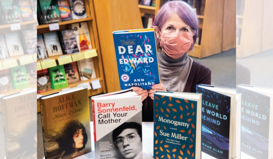 Employee Lily Bartels shows off her personal picks for holiday gifts at the Open Door Bookstore in Schenectady last month.