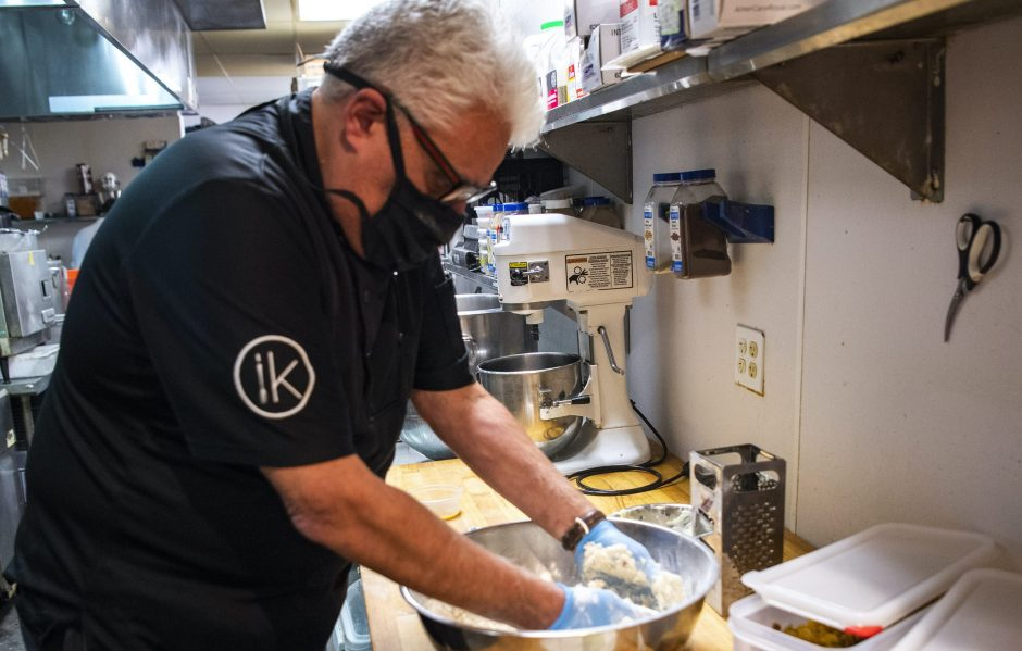 Innovo Kitchen chef John LaPosta prepares scones at the Latham restaurant. Innovo is offering boxed meals for Christmas this year, with available delivery.