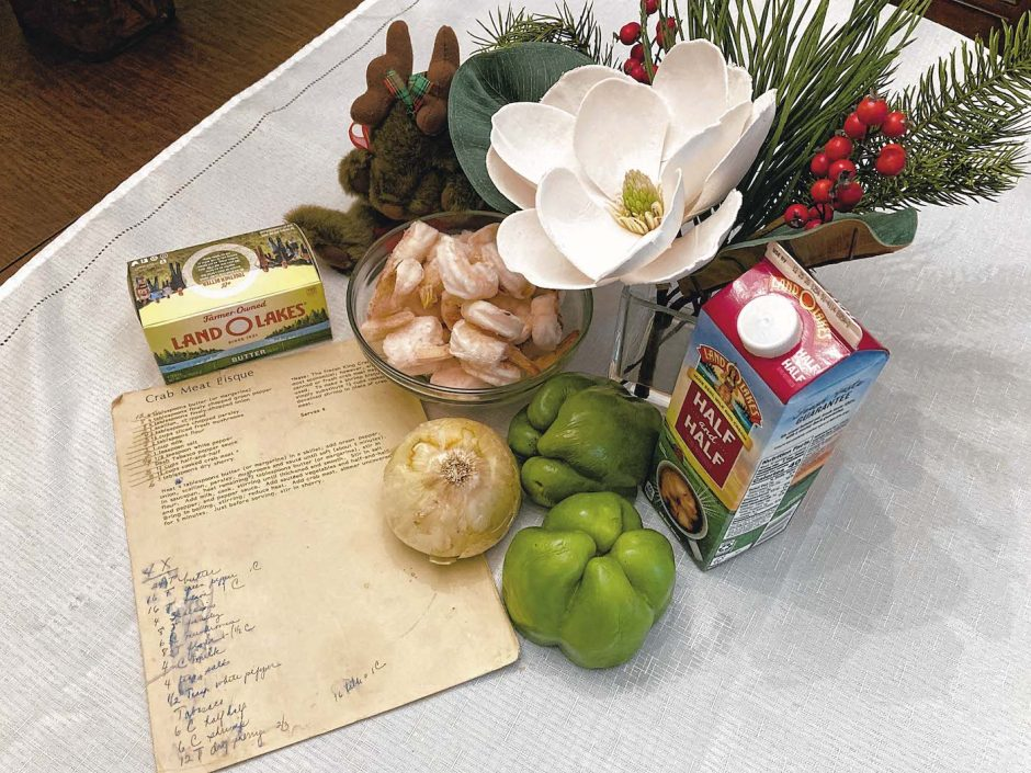 Ingredients for the writer's shrimp bisque, along with handwritten notes at the bottom of a well-worn recipe sheet.