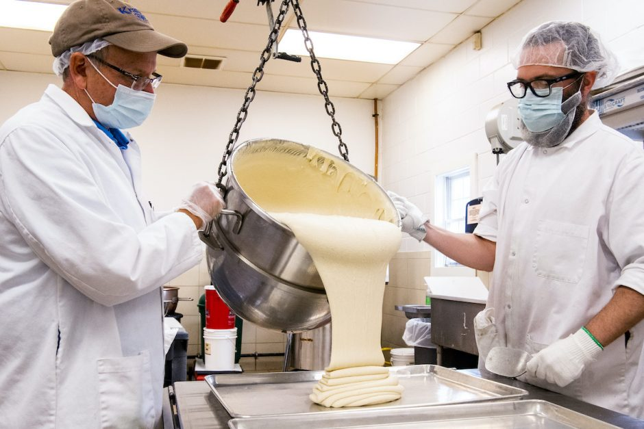 Tom Krause, left, owner of Krause's Homemade Candy on Central Avenue in Colonie, and an employee pour a fresh batch of marzipan onto a cookie sheet in November.