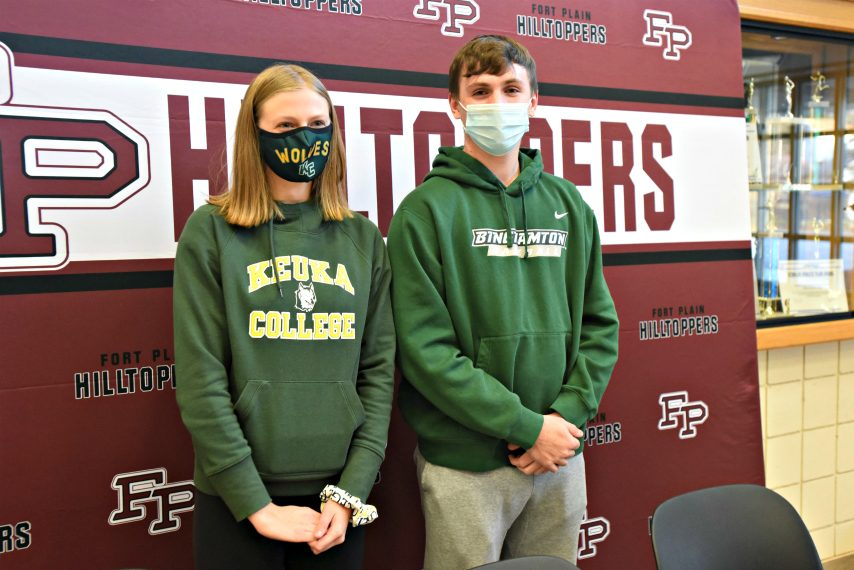 STAN HUDY/STAFF WRITERFort Plain seniors Sarah Paradiso and Troy Butler stand together after their college commitment celebration Tuesday in the lobby of Fort Plain Central School.