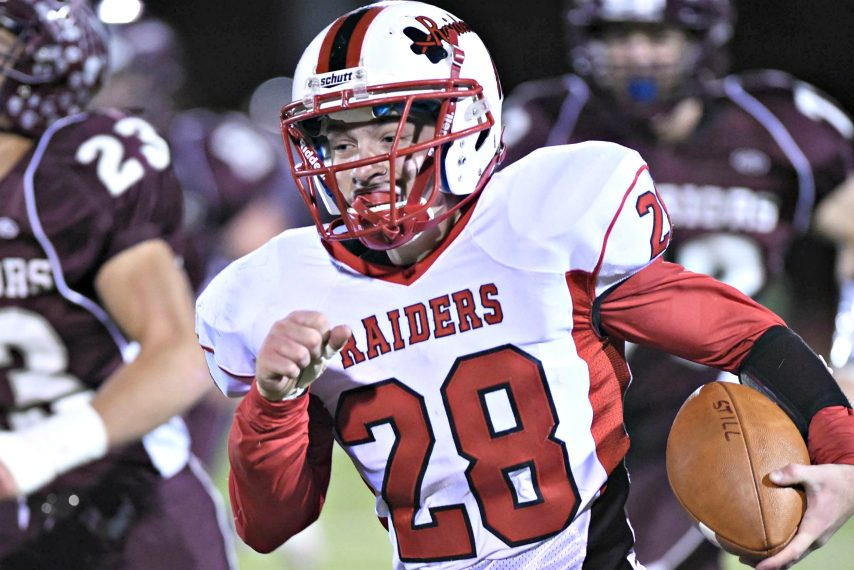 FILE PHOTOMechanicville Red Raider Jacob Henes runs with the football against local rival Stillwater.