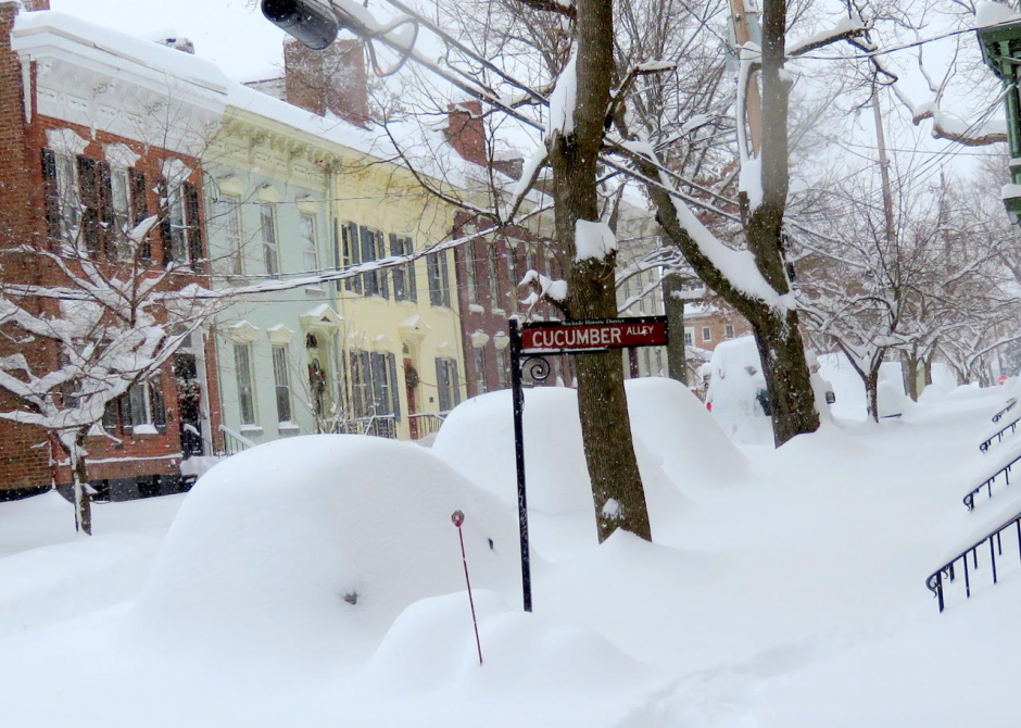 Vehicles remained blanketed in snow on Cucumber Alley in Schenectady's Stockade neighborhood on Thursday, December 17, 2020.