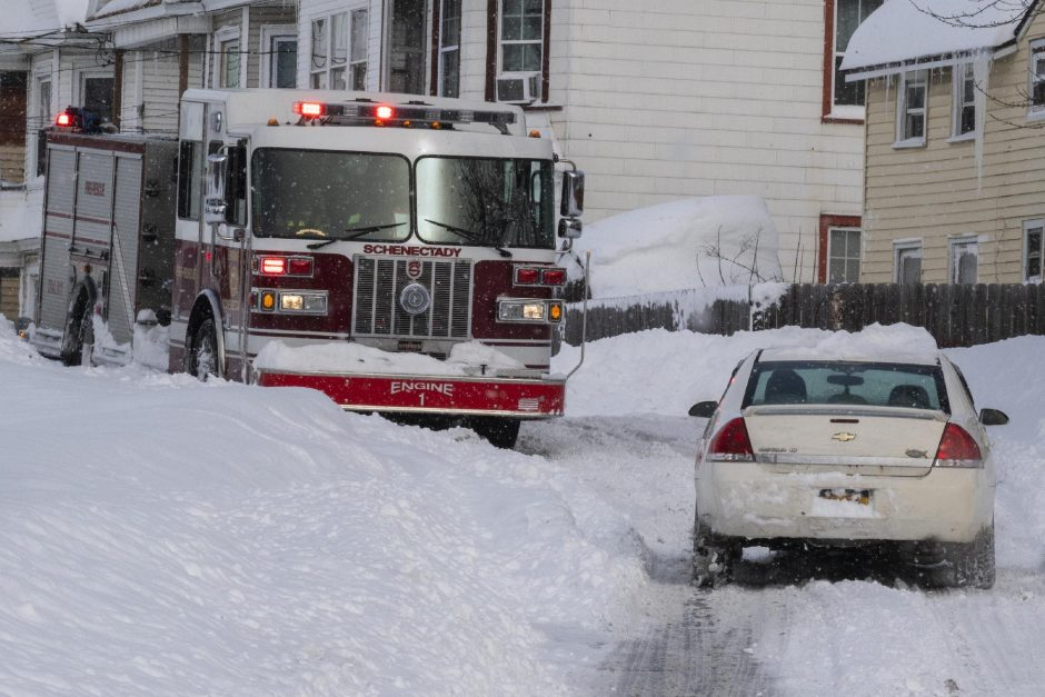 PETER R. BARBER/STAFF PHOTOGRAPHER Schenectady Engine 1 is stopped at Craig and Strong street for a medical on Hulett Stree in Schenectady Thursday, December 17, 2020. Roads were impassible so the paramedics had to walk to the scene.