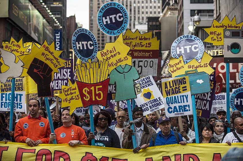 More than 1,000 people march for labor unions demanding a rise in minimum wage to $15 an hour in New York, April 15, 2016.