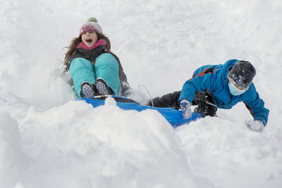 Emmerson McLaughlin, 8 of Saratoga Springs, rides down the hill crashing into new friend Willem Tensen, 8 of Saratoga Springs, on High Rock Ave Park after the snow stops falling in Saratoga Springs on Thursday, December 17, 2020.