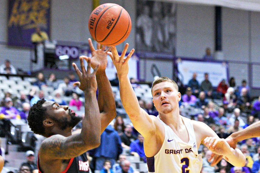 UAlbany's Trey Hutcheson tries to secure a loose ball during a game last season. (Gazette file photo)