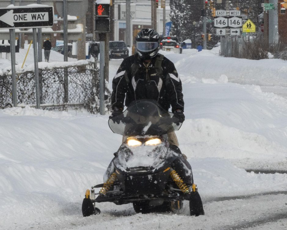 PETER R. BARBER/STAFF PHOTOGRAPHERA snowmobiler crosses Interstate 890 on Michigan Avenue in Schenectady Thursday.