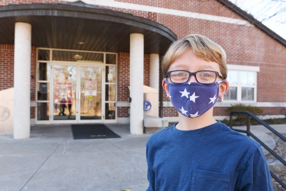 ERICA MILLER/STAFF PHOTOGRAPHER   Carter Dibble, 10 of Niskayuna, stands outside the Schenectady County Public Library Niskayuna branch on Tuesday, December 15, 2020.