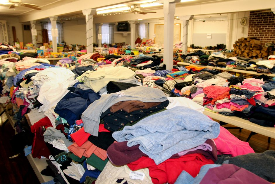 The dining hall of the H.C. Smith Benefit Club in St. Johnsville was filled with items for donation Sunday, including a vast selection of clothing. (Joshua Thomas/Staff Writer)