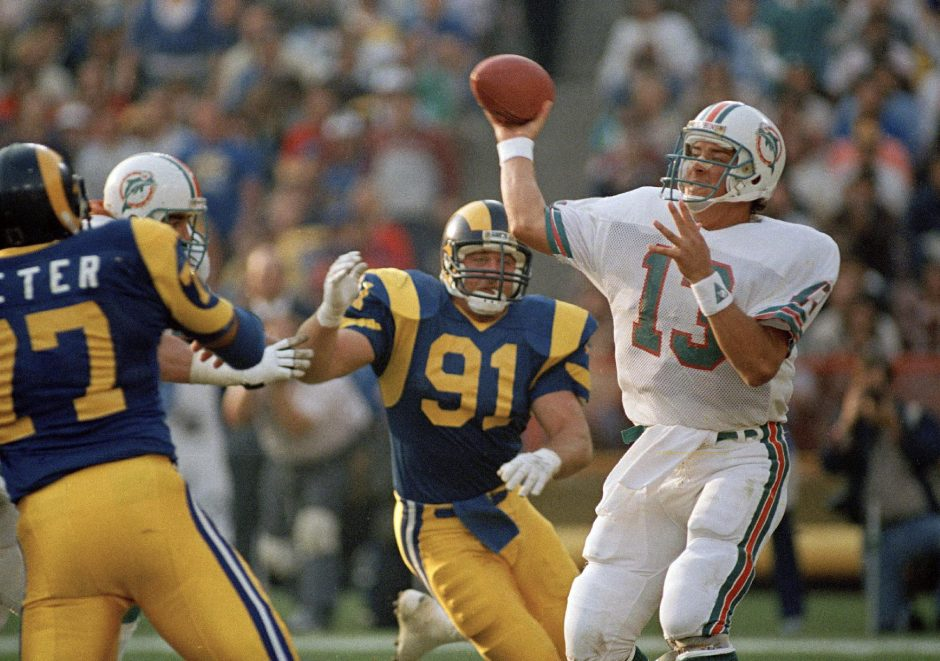 ROD BOREN/THE ASSOCIATED PRESSIn this Dec. 15, 1986, file photo, Kevin Greene of the Los Angeles Rams (91) puts pressure on Miami Dolphins quarterback Dan Marino.