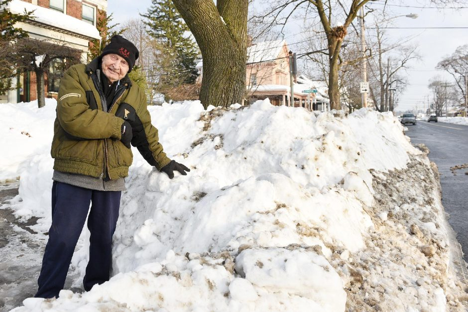 Jack Underwood, 92, stands outside his home on Upper Union Street Monday after a city plow deposited a mound of snow over 3 feet tall at the end of his driveway.