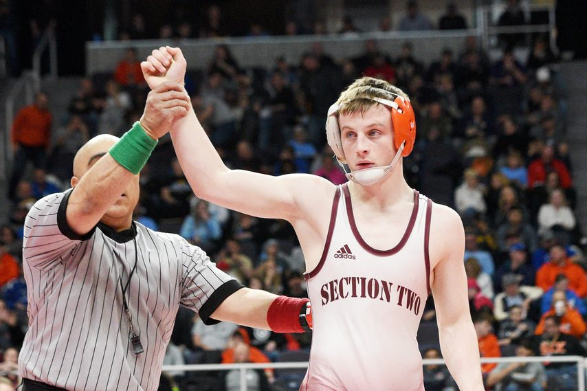 Jake Deguire of Mohonasen gets his hand raised after posting a 138-pound Division I win at the state wrestling championships at Times Union Center last February. (ERICA MILLER/STAFF PHOTOGRAPHER)