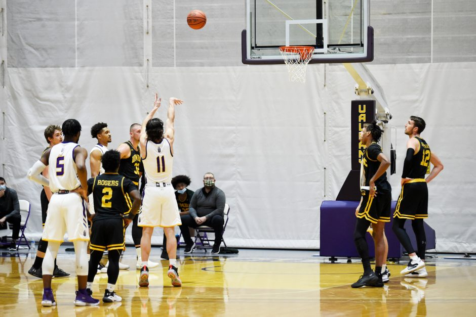 As UAlbany's Cameron Healy takes a free throw during a game last weekend, UMBC's 5-foot-2 Darnell Rogers (2) is shown next to UAlbany's 6-foot-4 Jamel Horton (5) at SEFCU Arena. (Photo courtesy Kathleen Helman/UAlbany Athletics)