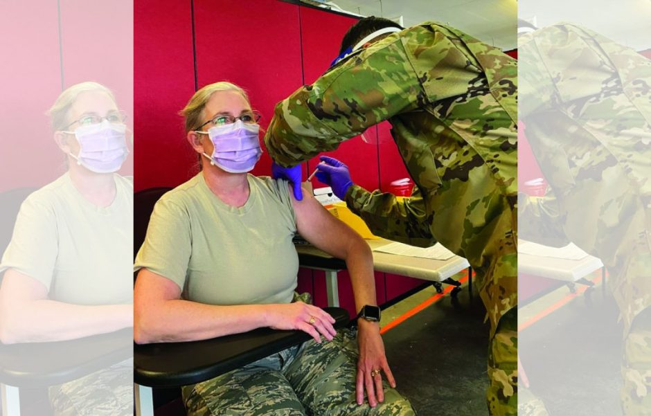 Major Rita O'Neill, a nurse practitioner at St. Mary's Healthcare in Canajoharie, receives a COVID-19 vaccine on Dec. 18, 2020 at Camp Smith in Cortland.