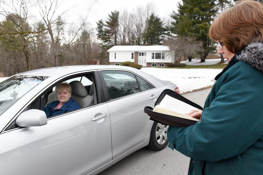 Rev. Judy Humphrey-Fox of Amsterdam, reads from the Bible to Betty Anderson, of Broadalbin, during their daily drive thru prayer and blessings at United Methodist Church of Amsterdam on Golf Course Road on March 24.