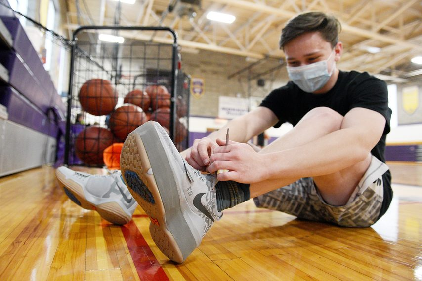 Saratoga Central Catholic junior Danny Mantia ties his modified sneaker during a recent non-contact basketball workout at the school. Multiple surgeries have enabled Mantia, who was born with PFFD, to play.