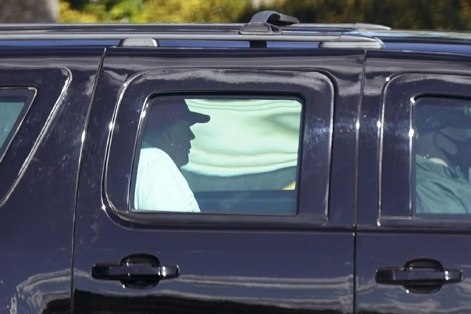 President Donald Trump rides in a motorcade vehicle as he departs Trump International Golf Club, Sunday, Dec. 27, 2020, in West Palm Beach, Fla. (AP Photo/Patrick Semansky)