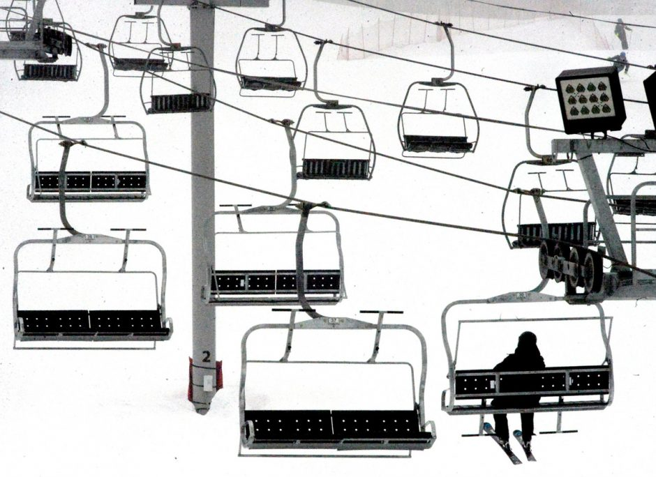 A lone skier sits on the chairlift in the fog at West Mountain in February.