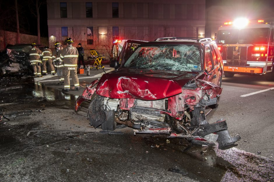 Schenectady firefighters work to free the driver.