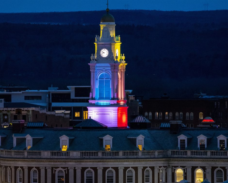 The City Hall spire is bathed in a kaleidoscope of color in Schenectady Tuesday, April 7, 2020.