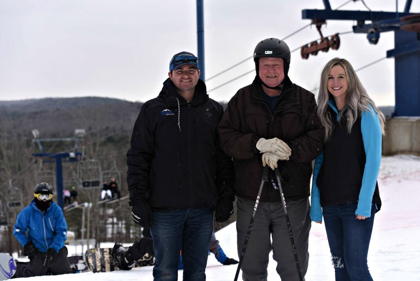 STAN HUDY/STAFF WRITERJim Blaise, center, will remain on staff with the new owners, Jake and Brooke Tennis, at Royal Mountain Ski Area in Caroga Lake.