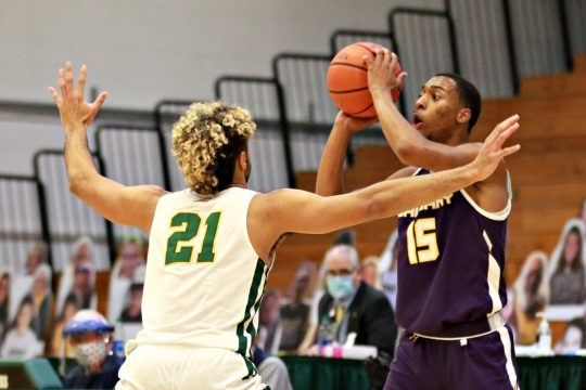 UAlbany's CJ Kelly, right, is defended by Vermont's JustinMazzulla during Saturday's game in Burlington. (Photo courtesyNich Hall/UVM Athletics)