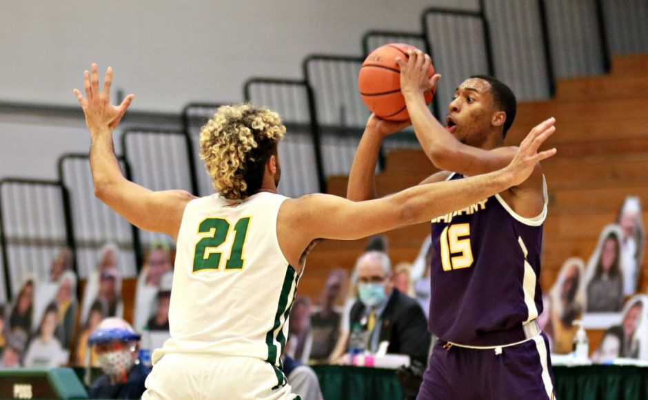 UAlbany's CJ Kelly, right, is defended by Vermont's Justin Mazzulla during Saturday's game in Burlington. (Photo courtesy Nich Hall/UVM Athletics)