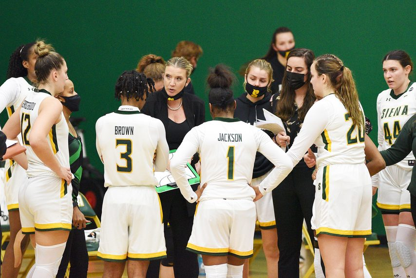 Siena women's basketball coach Ali Jaques huddles with her team during a Dec. 11 game in Loudonville.