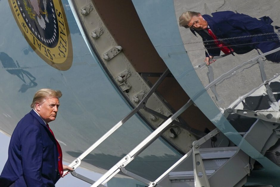 President Donald Trump boards Air Force One at Palm Beach International Airport, Thursday