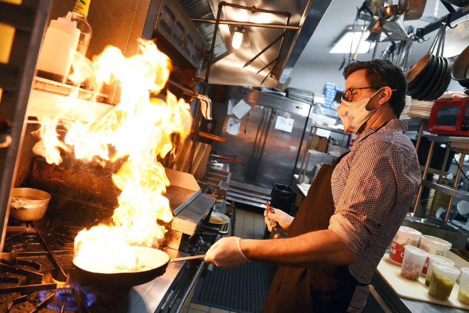 Nanola Restaurant owner Shane Spillenger cooks up a pasta dish