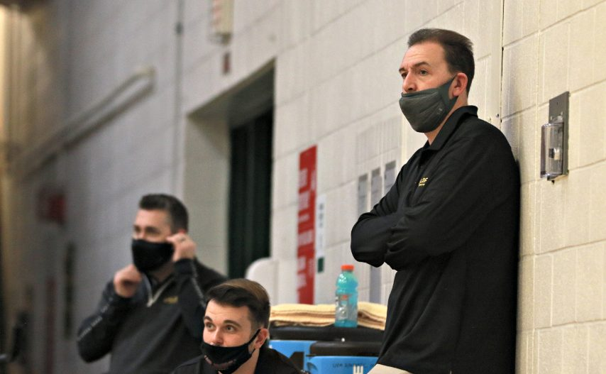 UAlbany head coach Will Brown, right, is shown during Sunday's game in Burlington, Vermont. (Nich Hall/UVM Athletics)