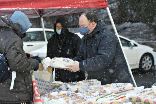 Daniel Werblin of Niskayuna offers a loaf of bread