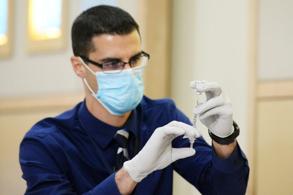 Albany Med Director of Pharmacy Anthony DiSpirito readies vaccines in Albany, Dec. 14